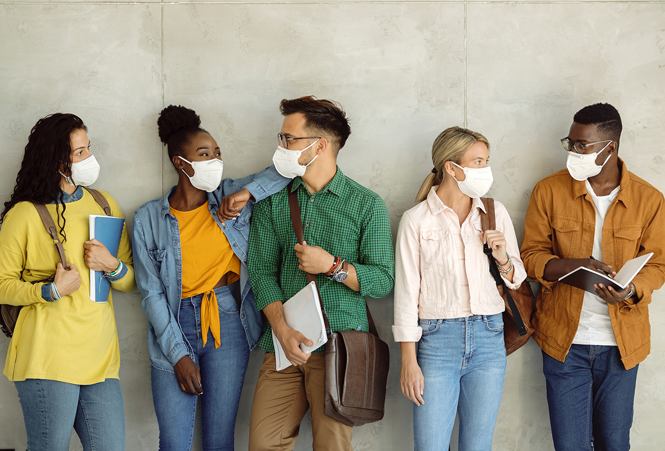 Photo of a group of people wearing masks