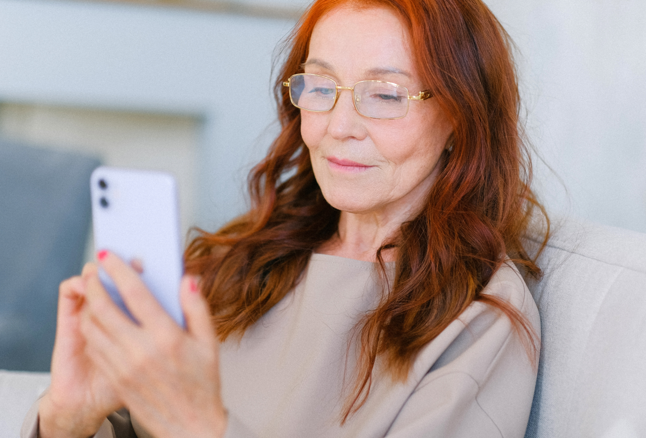 Woman reading a COVID-19 exposure notification on her phone