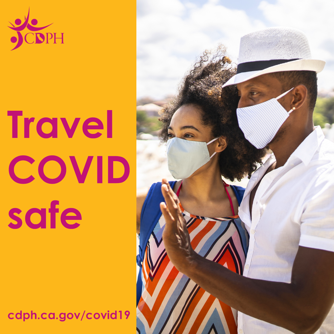 photo of a couple who are traveling wearing masks